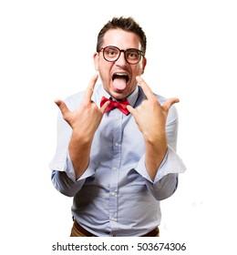 Man wearing a red bow tie. Rocker gesture.