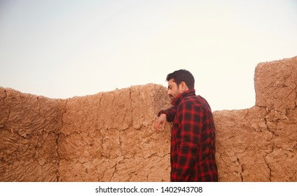 Man wearing red shirts standing around a place unique photo