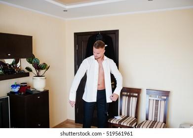 Man wearing shirt. Groom morning at wedding day.