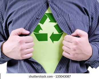 A man wearing shirt transforming into Eco superhero with green recycle arrow symbol underneath on chest - recycle concept