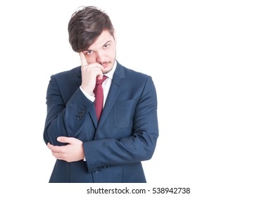 Man wearing suit being pensive or thinking at something isolated on white background with copy text space
