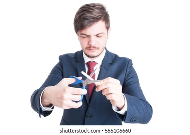 Man wearing suit cutting cigarettes with eyes closed like quitting concept isolated on white background with copy advertising area