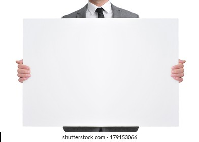 a man wearing a suit holding a blank signboard with a copy-space