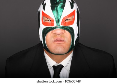 Man wearing a suit and luchador mask.