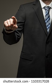 Man wearing suit pointing finger