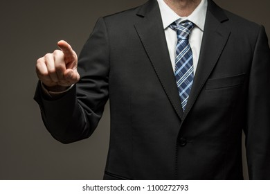 Man wearing suit pointing his finger