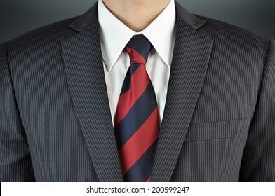 A man wearing suit with stripe necktie - business attire