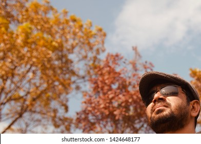 Man wearing sunglass and cap standing in a place