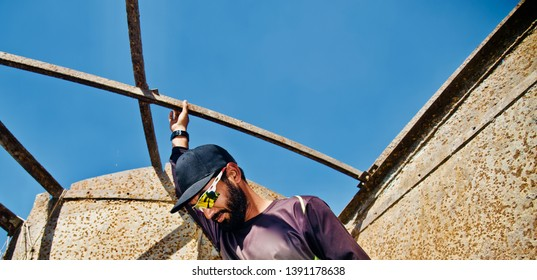 Man wearing sunglass and caps standing in a place unique photo