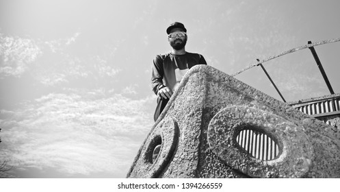 Man wearing sunglass standing on an old metallic boat unique photo