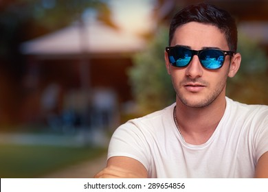 Man Wearing Sunglasses Waiting in a Restaurant - Portrait of a handsome with sport style sunglasses with mirror lenses