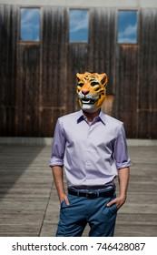 man wearing tiger mask outdoor
