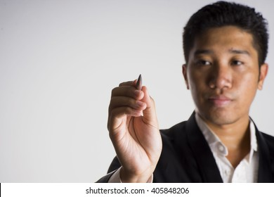 A man wearing tuxedo hold a pen point on screen, select focus - business concept