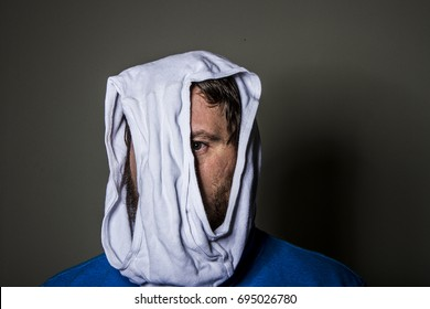 man wearing underwear on his head