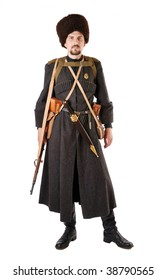 Man is wearing vintage uniform of Russian foot Cossack in time First World War. He is member of Living History Society. Re-enactor is carried military equipment. He has dagger and rifle.
