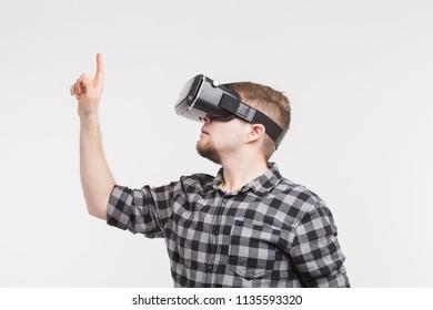 Man wearing virtual reality glasses raising his hand