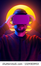 Man wearing virtual reality goggles wireless headset. VR videogame experience in 80's synthwave and retrowave futuristic aesthetics.