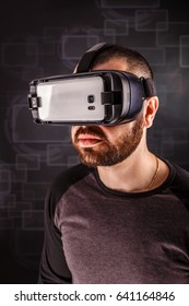Man wearing virtual reality goggles, studio shot
