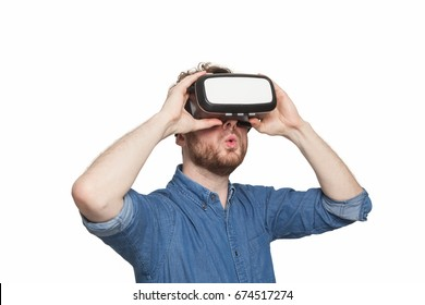 Man wearing virtual reality goggles, isolated on white