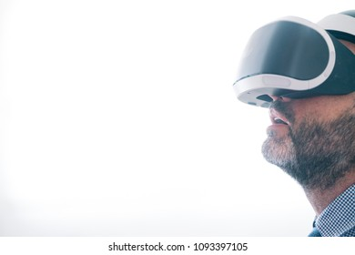 Man wearing virtual reality headset at home