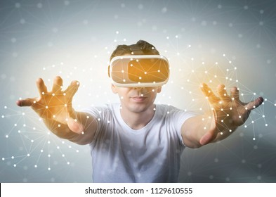 Man wearing virtual reality headset and touching abstract mash interface