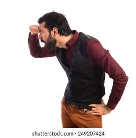 Man wearing waistcoat showing something