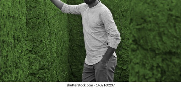 Man wearing white full sleeve t shirt standing in a place