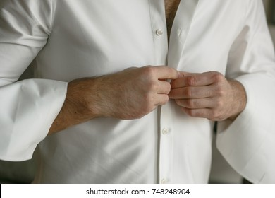 Man wearing a white shirt.