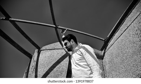 Man wearing white shirt standing in a place unique stock photo