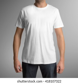 Man wearing white t-shirt isolated on gray background, with clipping path to change background