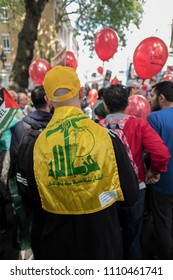 A man wears the Hezbollah flag in London during the Al Quds Day rally, London, 10/06/18.