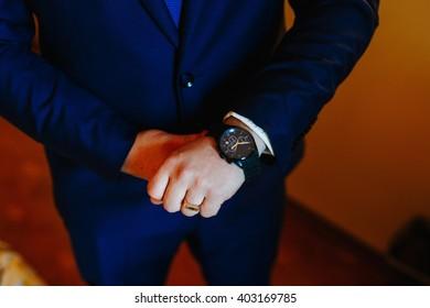 The man wears a watch