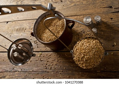 Man Weighs Malt for Home Brewing of Beer. Top View.