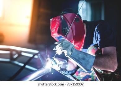 Man welding aluminum construction with TIG welder