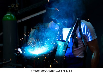 man welding metal in the factory