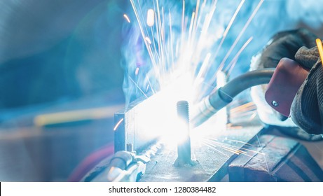 Man Welding steel