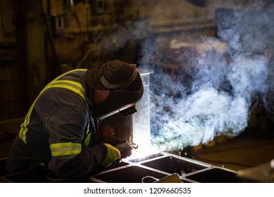 Man welding steel in a factory