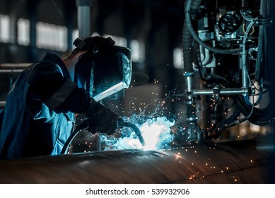 man welds at the factory