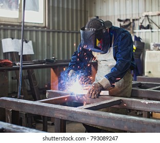 Man welds steel construction