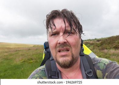 Man with wet hair and sweaty face looking exhausted and challenged