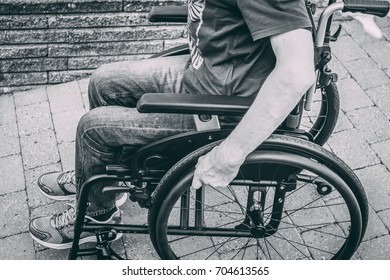 Man in wheelchair black and white