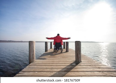 man in wheelchair enjoying his freedom at lake