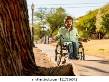 Man in a wheelchair gestures at sidewalk obstacle