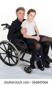 Man in wheelchair with his grand daughter isolated