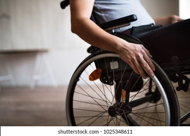 Man in wheelchair at home or in office.