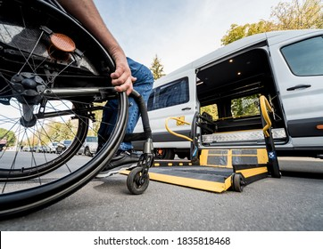 A man in a wheelchair moves to the lift of a specialized vehicle  - Shutterstock ID 1835818468
