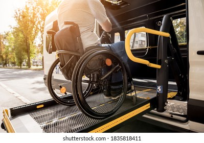 A man in a wheelchair on a lift of a vehicle for people with disabilities - Shutterstock ID 1835818411