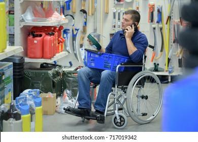 man in wheelchair shopping in hardware store
