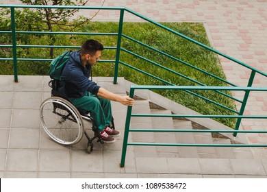 man in a wheelchair using a ramp