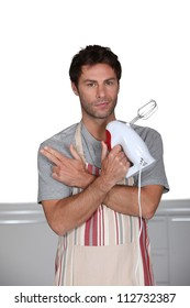 Man with a whisk